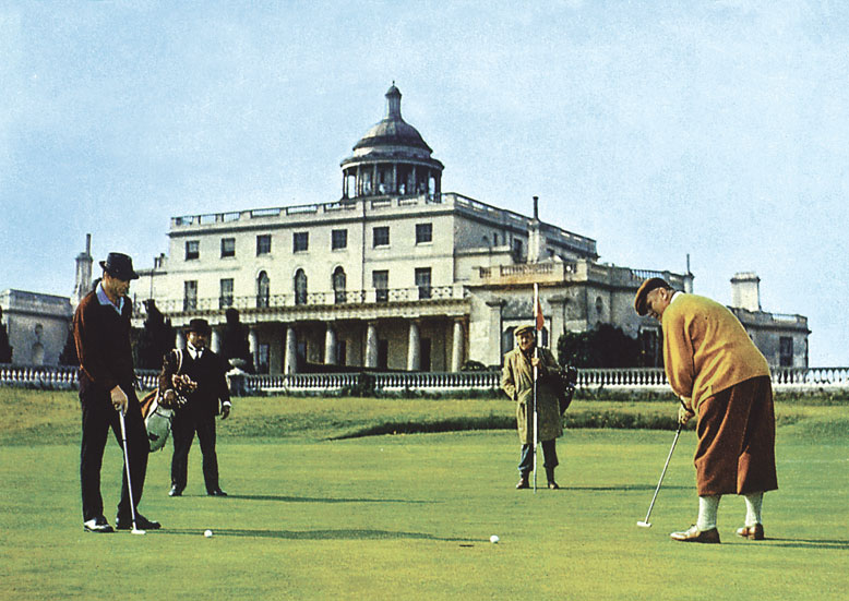 Gert Frobe putts out at Stoke Park